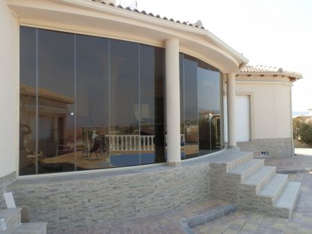 Campos Del Rio- Curved Terrace. Tinted Glass